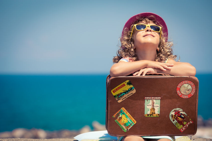 38259947 - child with vintage suitcase on summer vacation. travel and adventure concept